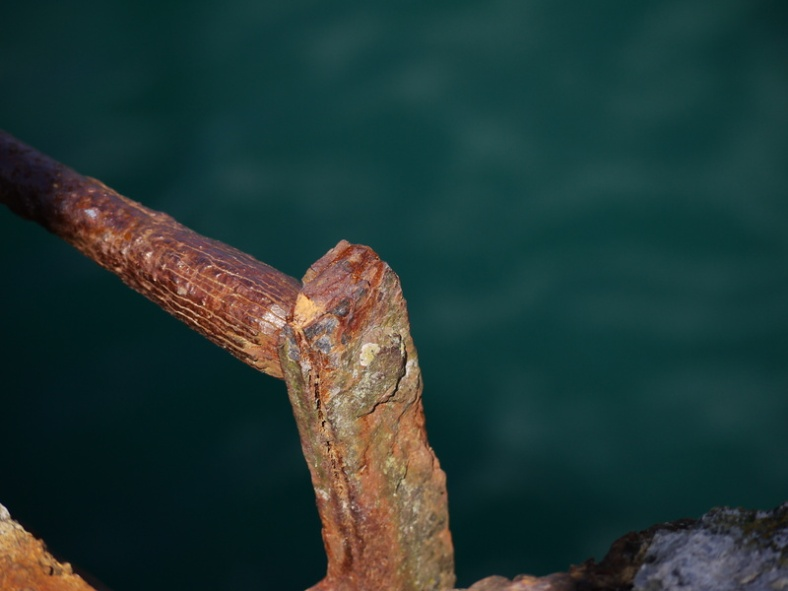 A rusted ladder by the sea in the port of Morgat, Crozon, France.