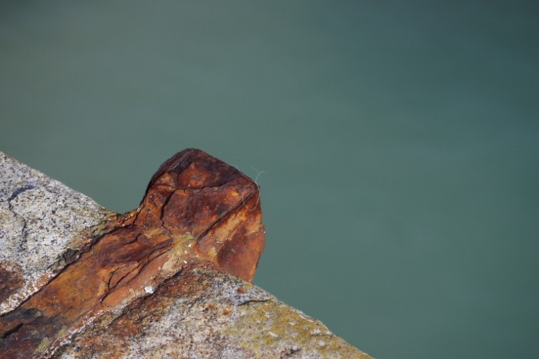 Rusted piece of metal above the sea, Cancale, France.